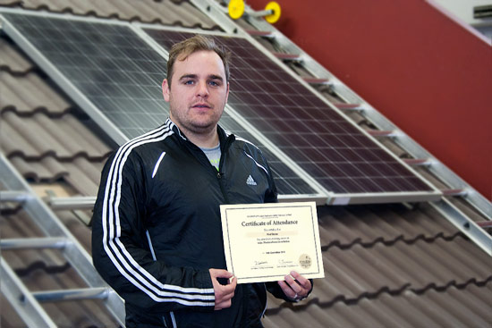 Paul Standing With Certificate